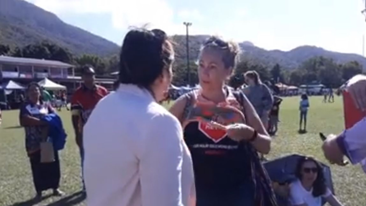 An anti-Adani protester speaks with Queensland MP Leeanne Enoch. Picture: Facebook/StopAdaniCairns