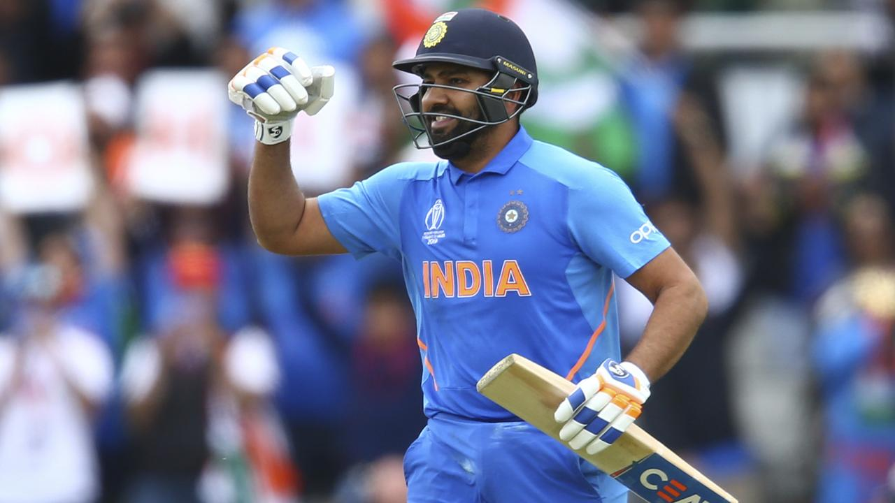 Rohit Sharma celebrates his second century of the tournament.