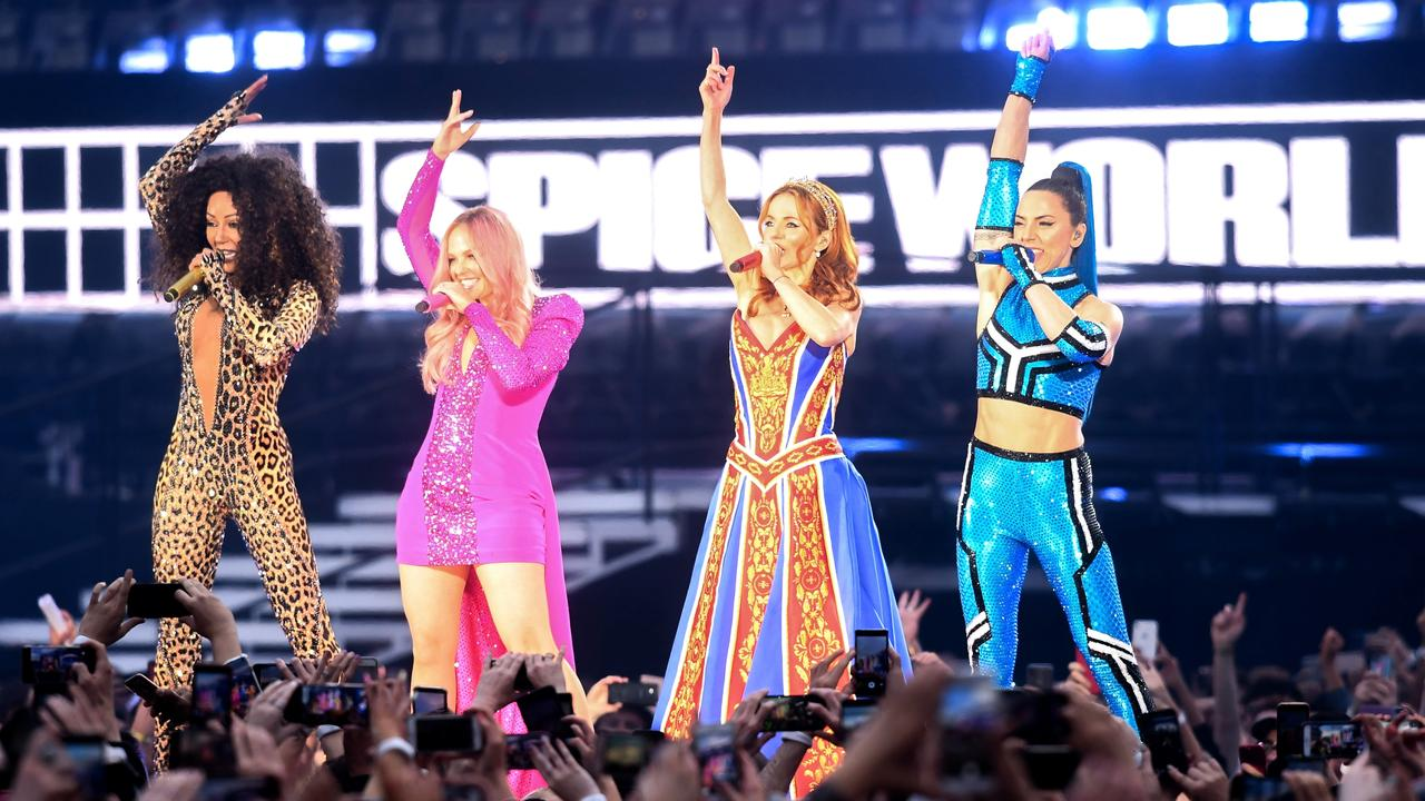 Mel B, Emma Bunton, Geri Halliwell and Melanie C of The Spice Girls perform on the first night of the UK reunion tour.