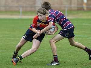 Kyle Hibbins (left) of South Toowoomba is tackled by