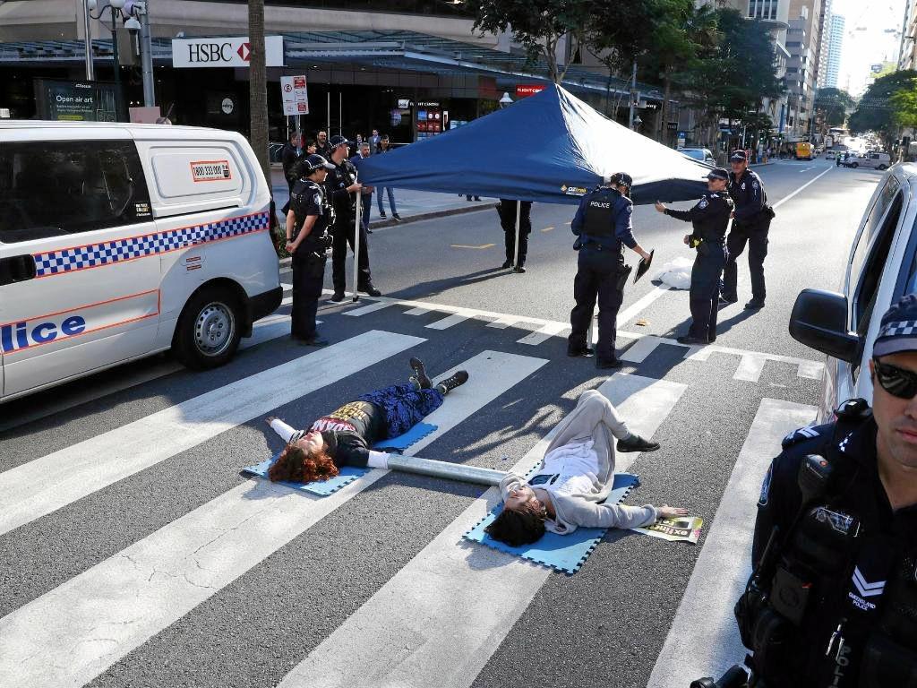 Protesters on a zebra crossing in Brisbane's CBD.