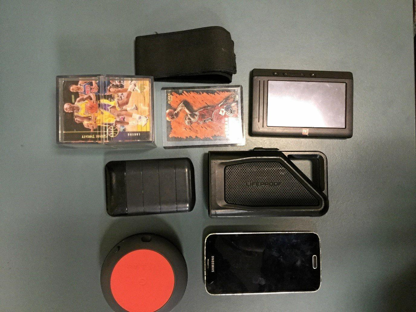 Some of the items seized by police including basketball cars and a mobile phone.