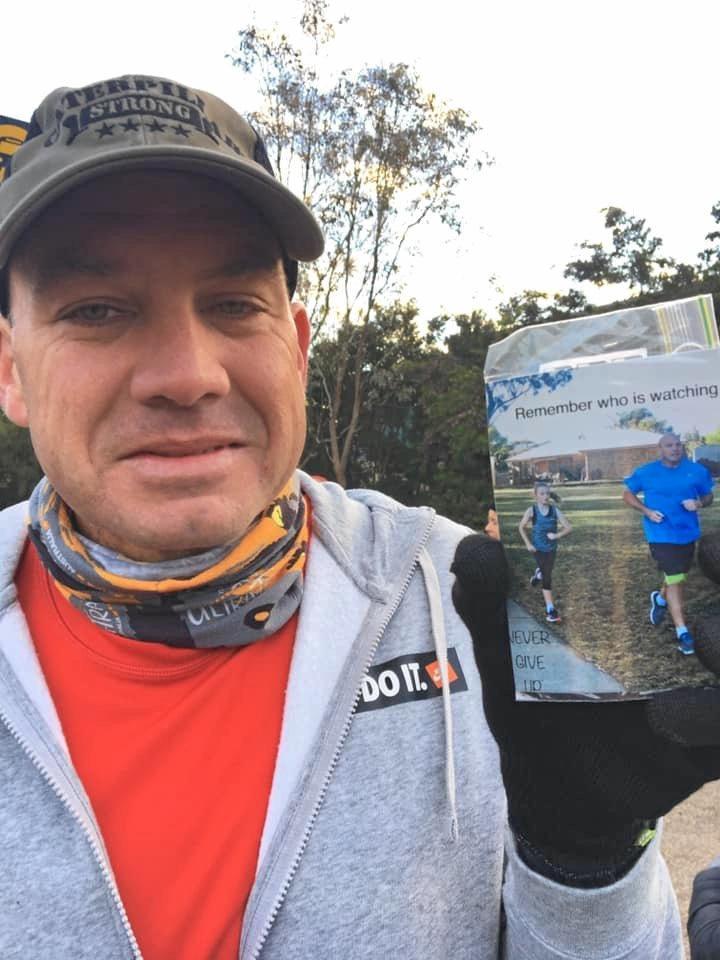 Shaun Cavanough with a photo that motivates him during his running.