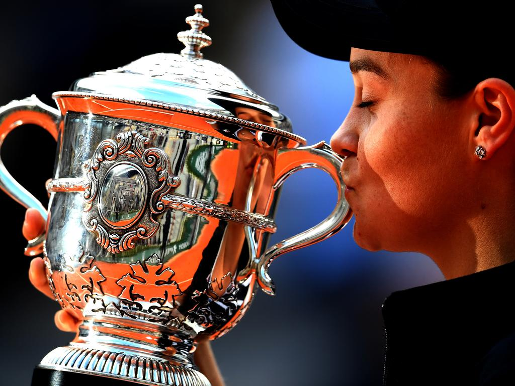 Ash Barty of Australia kisses the French Open trophy at Roland Garros.