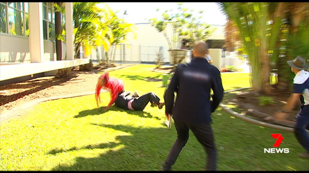 A top Sunshine Coast detective has crash tackled a serial pest who was interupting a police press conference.