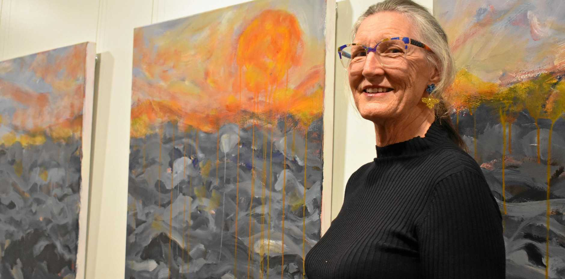 LOCAL ART: Barbara Hancock standing with her latest piece The Brigalow Sunset at the Heading in the Same Direction art exhibition in Roma.