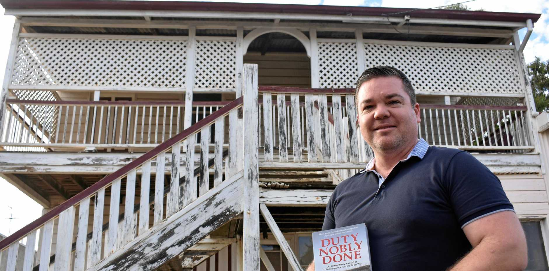 BOOK TOUR: Adam Holloway stands in front of 84 Wyndham St (also in inset), where his book Duty Nobly Done begins.