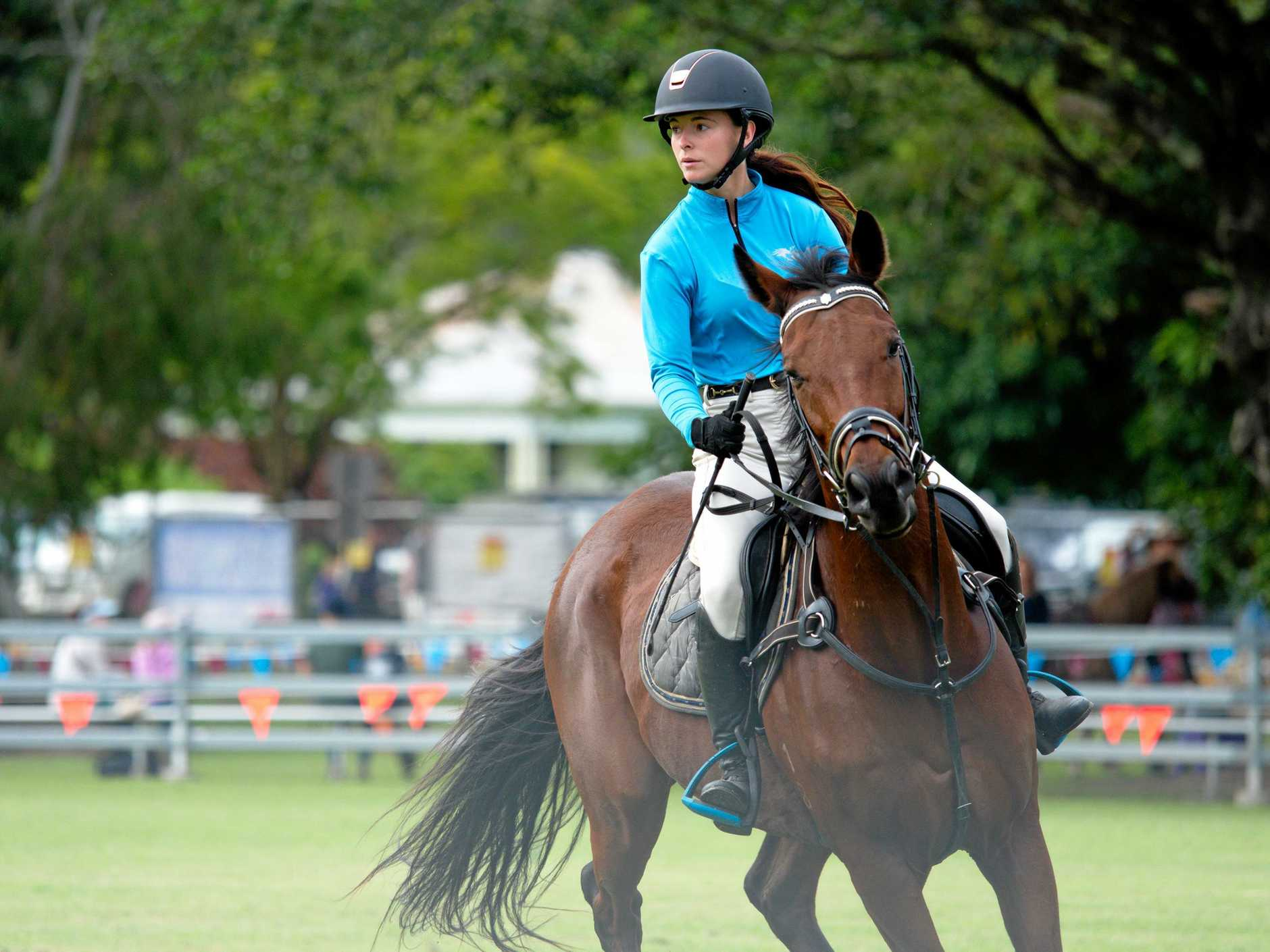 Abigail Lee in the main show ring during equestrian competition at the Pioneer Valley Show.