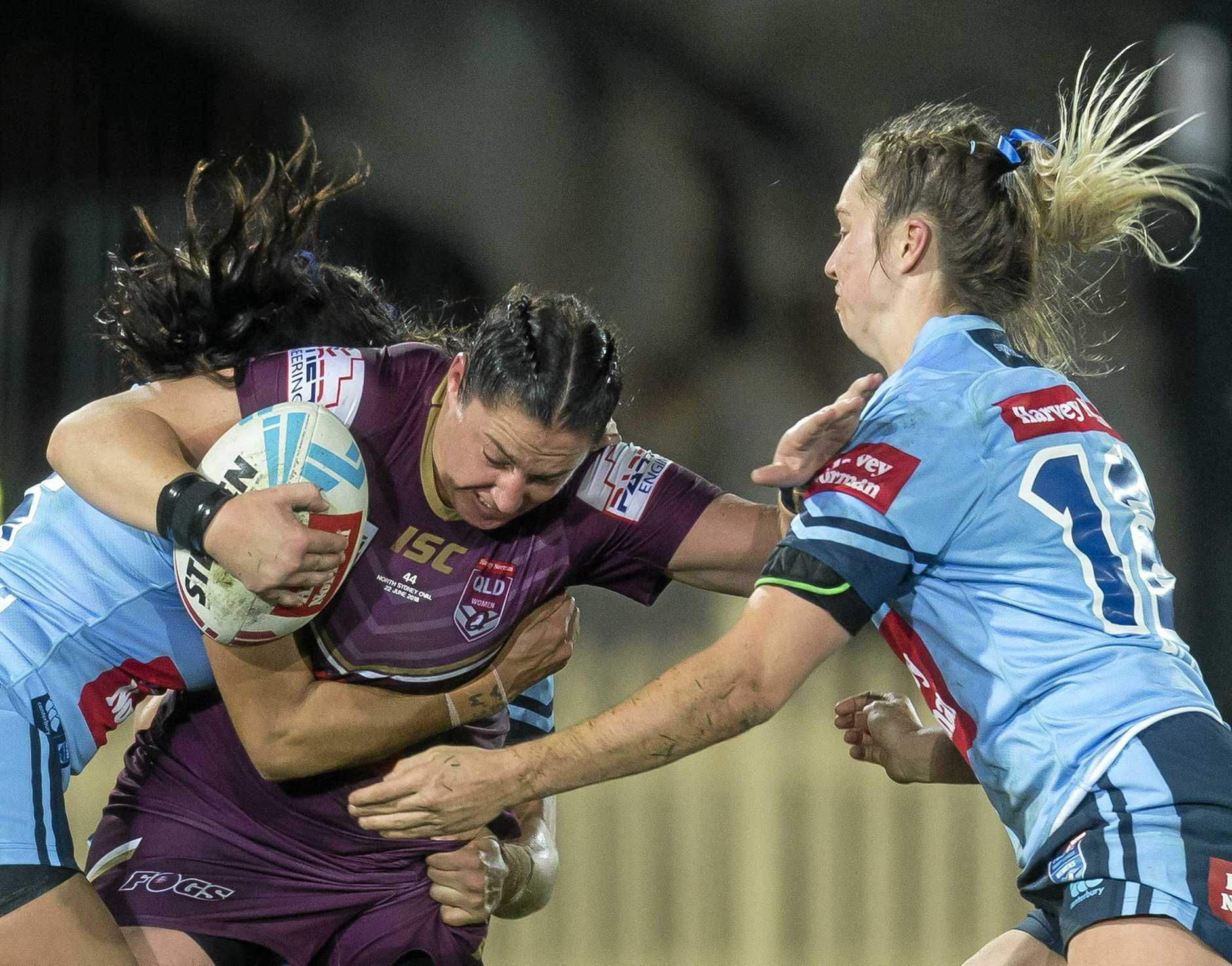 Stephanie Hancock of the Maroons is tackled during the Women's State of Origin match between the NSW Blues and Queensland Maroons at North Sydney Oval in Sydney, Friday, June 22, 2018. (AAP Image/Craig Golding) NO ARCHIVING, EDITORIAL USE ONLY