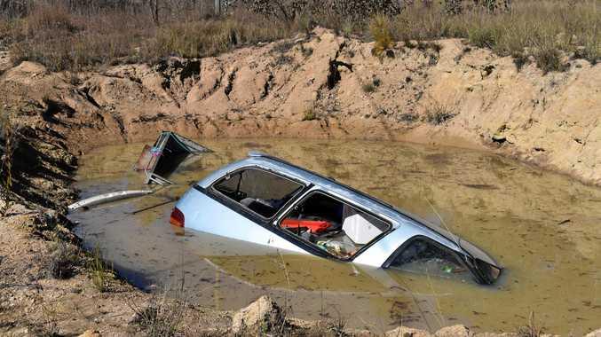 Van goes into dam
