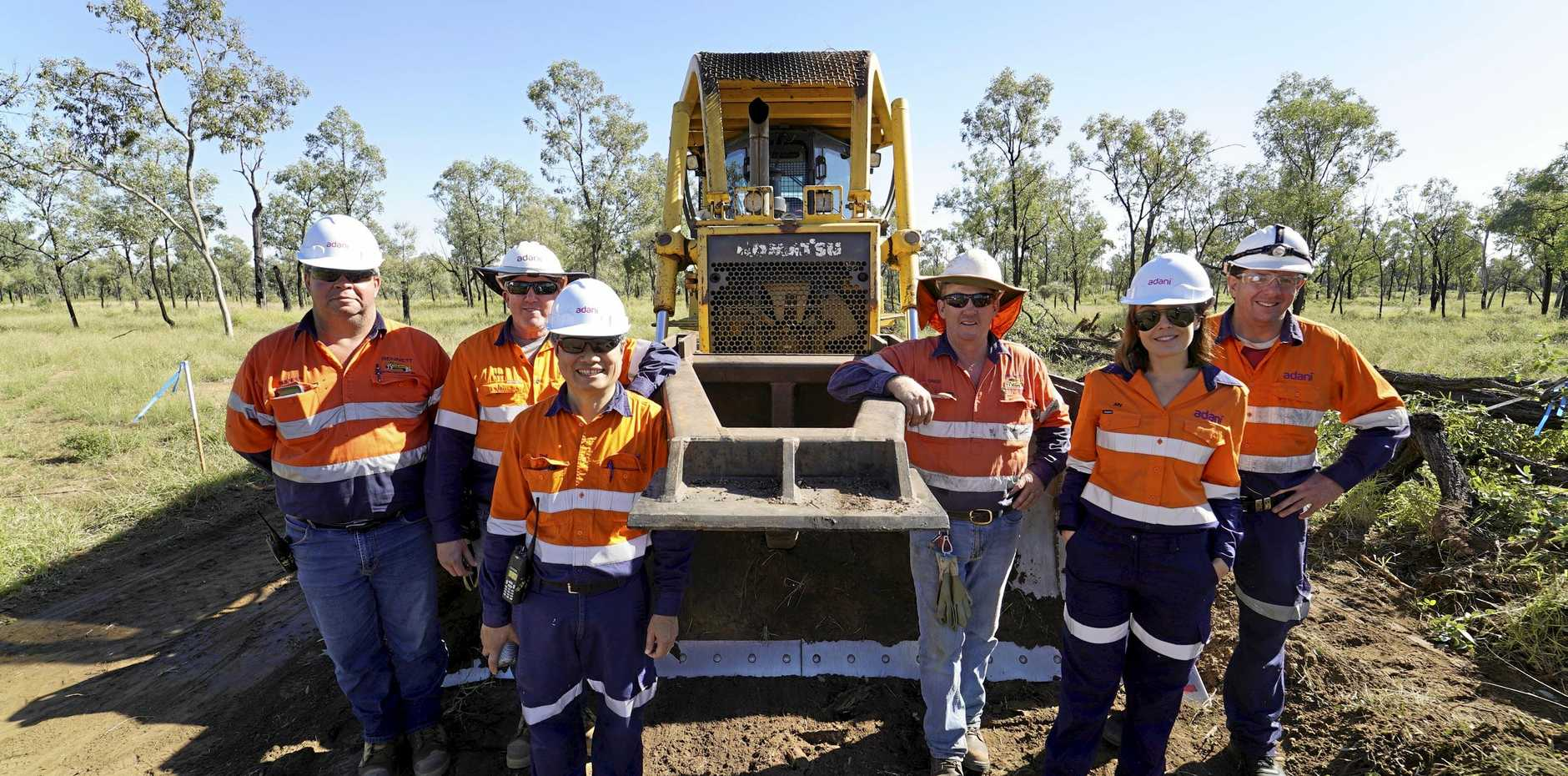 Brenden Dousling (Clermont), Allan Skillings (Adani), Ted Pham (Adani), Greg Bennett (Clermont), Ally Foley (Adani) and Mick Heap (Adani) commencing construction at the Carmichael Mine.