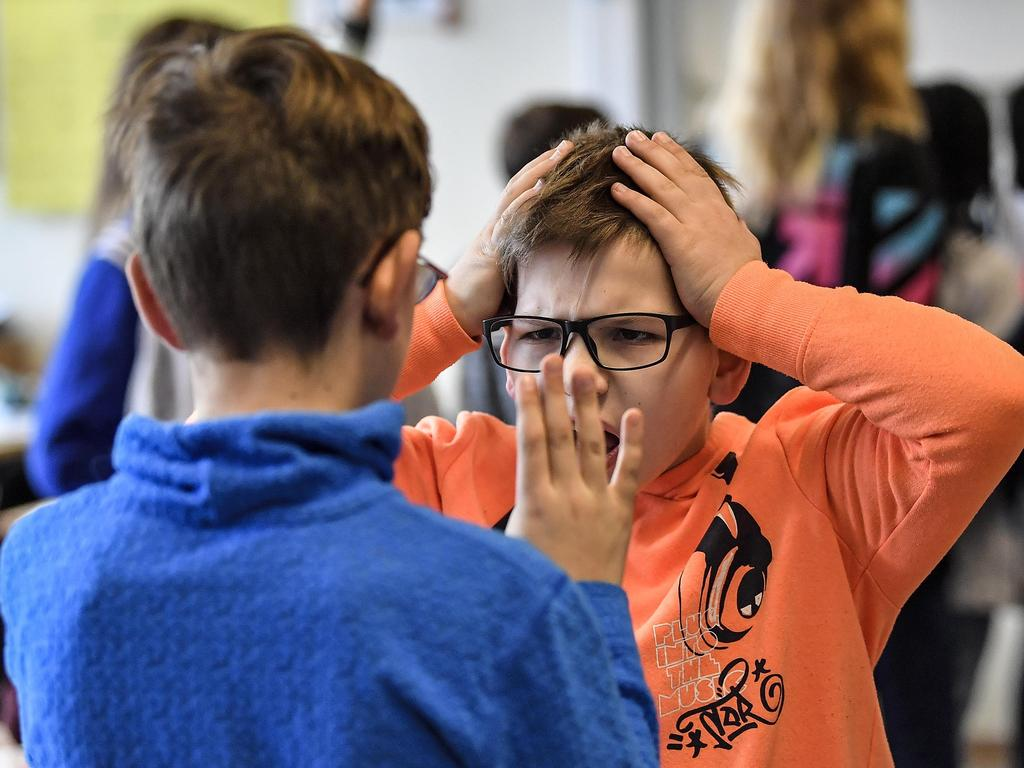 Students in Germany practise strategies for dealing with bullies.