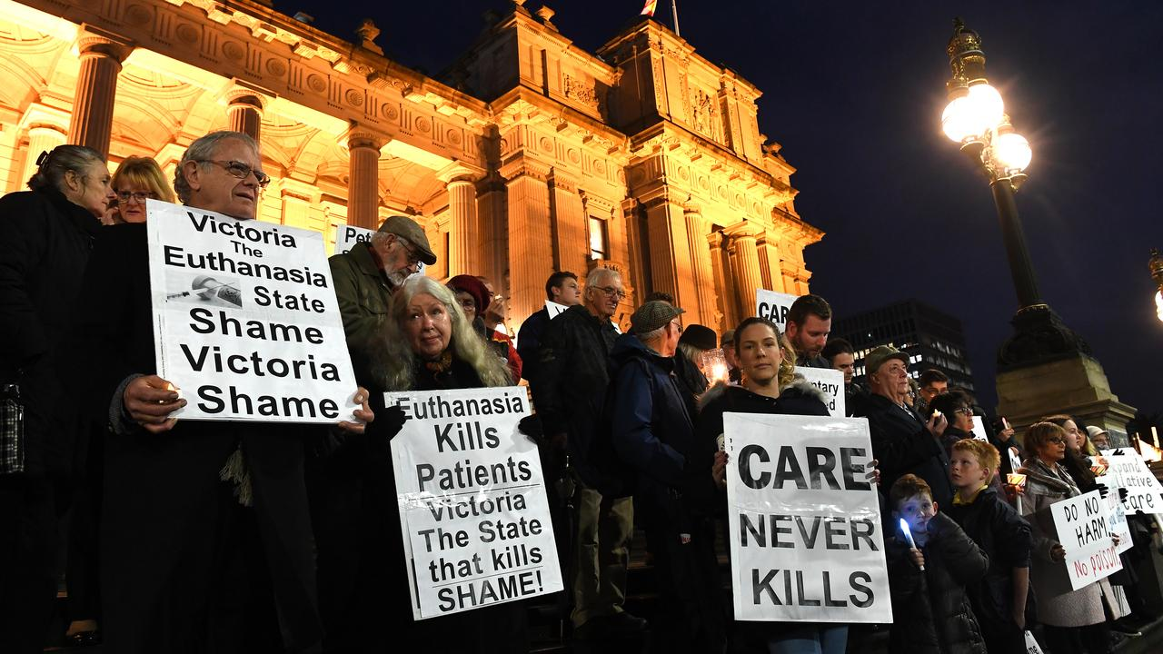 Pro-life demonstrators outside Victoria's Parliament House on Tuesday night. Picture: AAP/James Ross