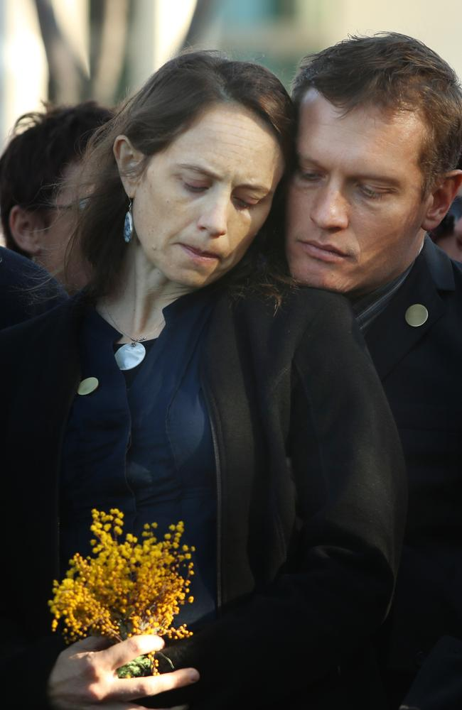 Paul Guard with his wife Jessie Wells at a national memorial service in Canberra for the first anniversary of the downing of Flight MH1. Picture: Gary Ramage