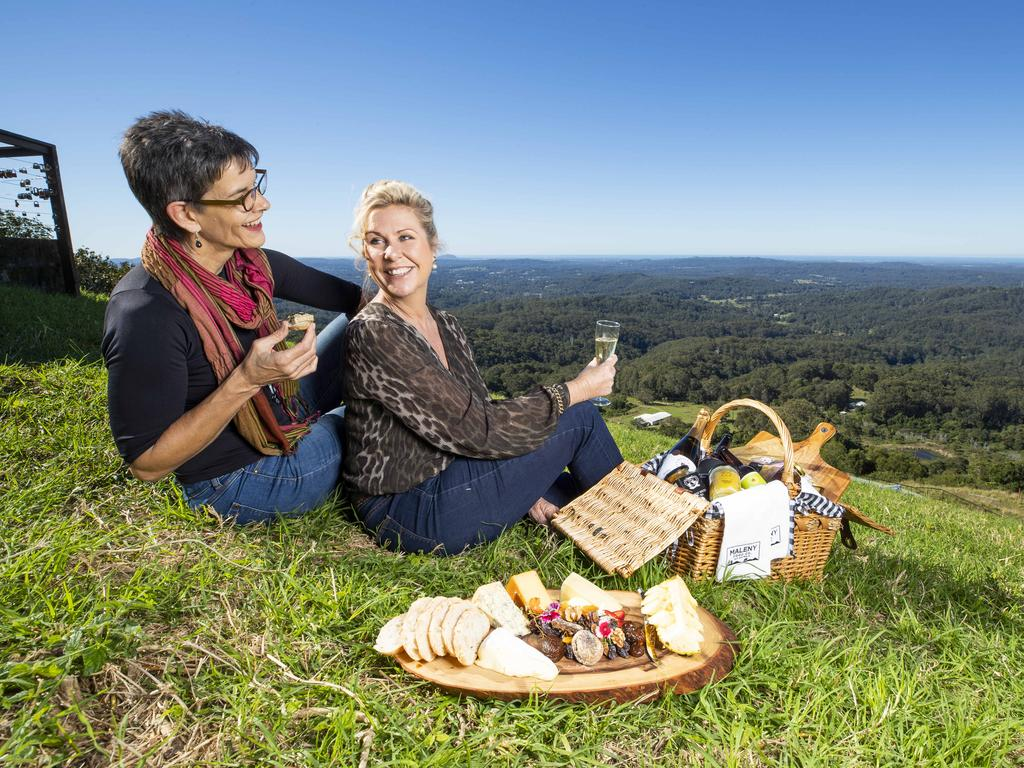 Jennifer Swaine of Palmwoods and Karen Barnett of Montville enjoy a picturesque ladies' picnic in the Sunshine Coast hinterland. Picture: Lachie Millard