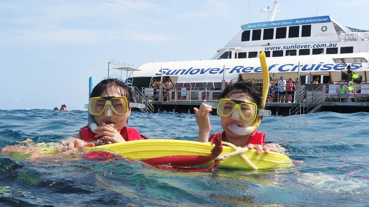 Korean tourists Nuri Kim and Su Yeon take a guided snorkel tour on Moore Reef with Sunlover Reef Cruises. The number of Korean visitors to the region rose by 62.8 per cent in the past 12 months. PICTURE: BRENDAN RADKE
