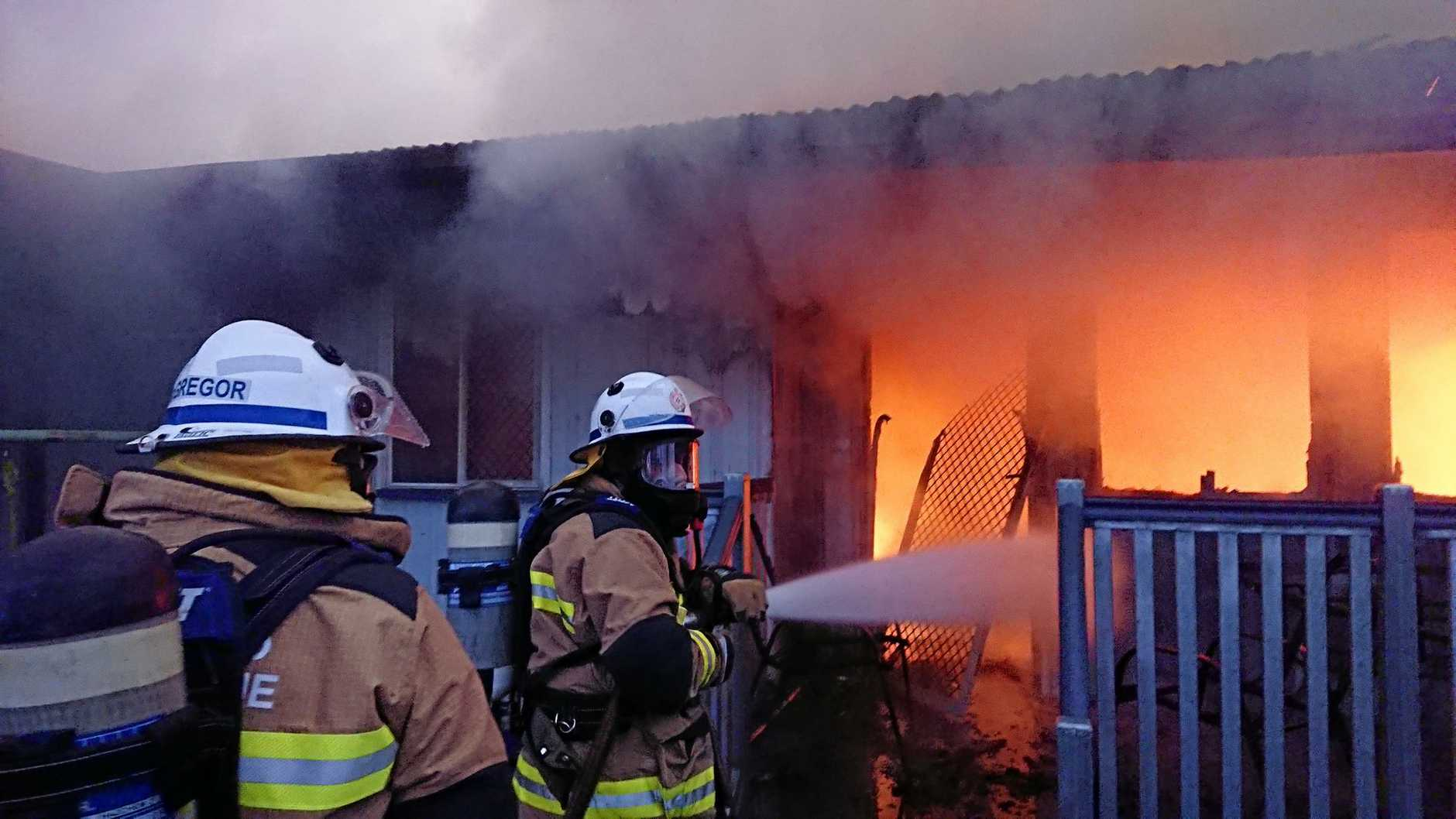 OAK AVE FIRE: Fire crews put out the blaze which engulfed the Cherbourg family home.