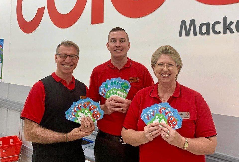 MACKAY TEAM: Merv Matsen, Shaun Foster and Wendy Franklin show the $2 donation cards at Coles Sydney Street, Mackay.