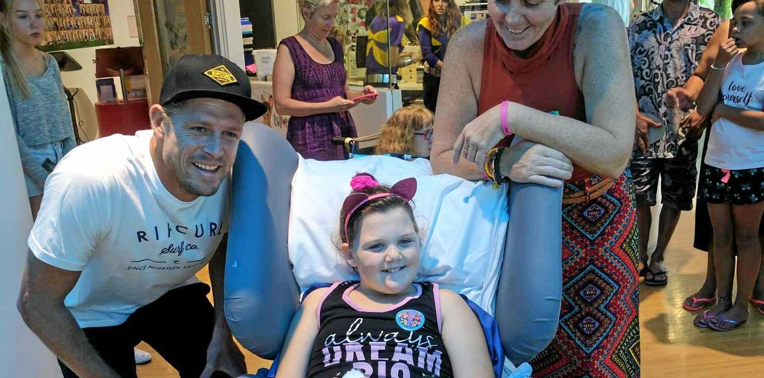 Tembi-Rae, 9, and mum Dimmity Ward with Australian surfer Mick Fanning at the Lady Cilento Children's Hospital.