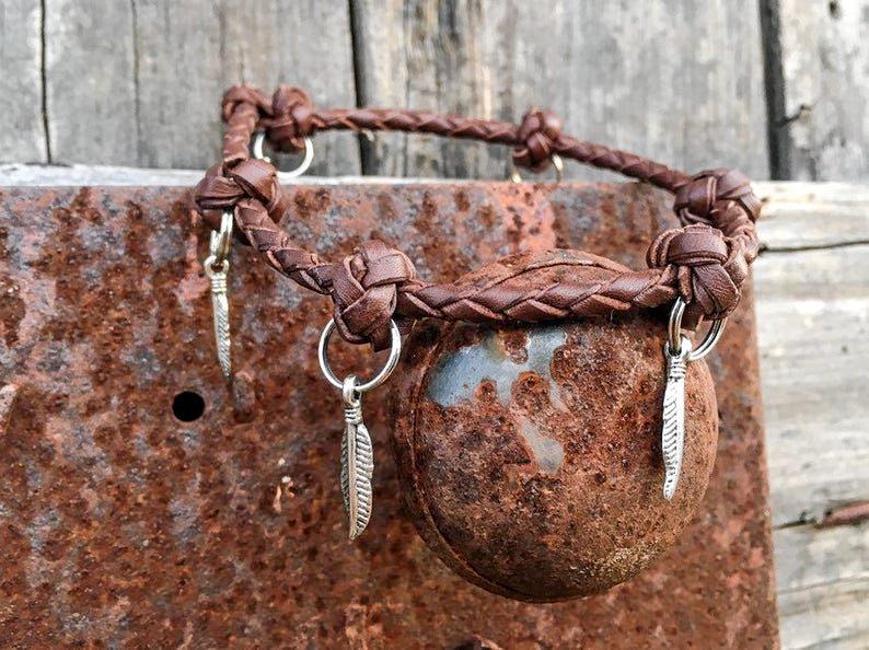 LITTLE BEAUTY: Local artist Penny Kittel turns Kangaroo leather into detailed bracelets and earrings.