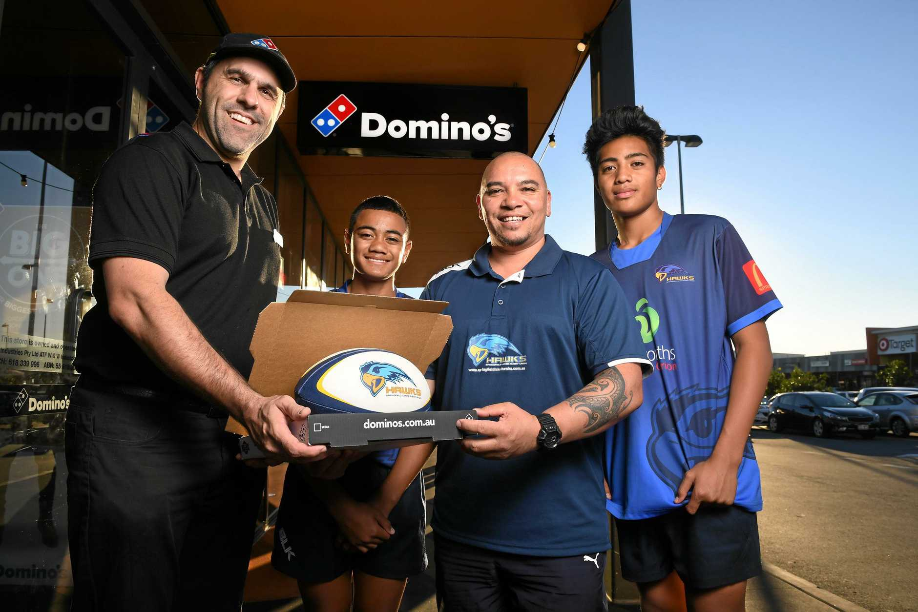 Domino's franchisee Morgan Wilkins is holding a fundraiser to raise money for the Springfield Lakes Hawks Rugby Union Club. Pictured with player Tafito Ahki, sponsorship coordinator Nathan Ferrier and player Henry Segi.