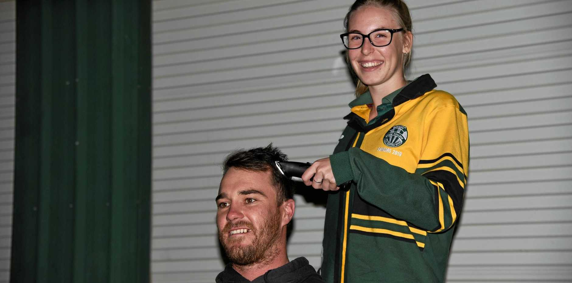 BUZZ: Gayndah Gladiators captain Zac Dann and Kirsty Taylor, who is fundraising for the World's Greatest Shave.
