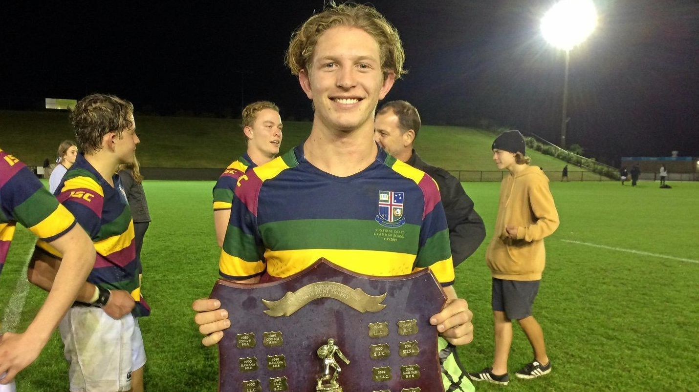 Sunshine Coast Grammar's Nick Lloyd proudly holds the Garth Hunt Shield following his side's victory over Siena Catholic College at Sunshine Coast Stadium on Wednesday night.