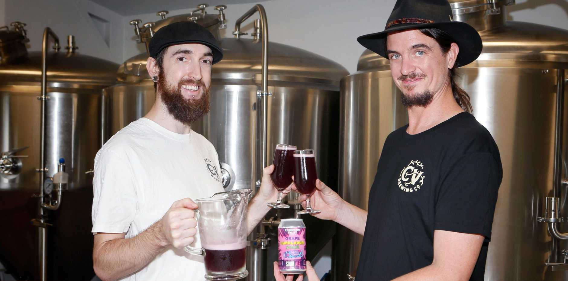 Currumbin Valley Brewing's Luke Ronalds and Peter Wheldon toast the success of their Grape Bubblegum Sour brew which was named the People's Choice at the Great Australasian Beer Spectacular.