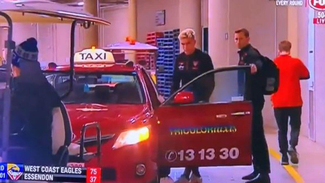Matt Guelfi was taken to hospital in a taxi. Picture: Fox Footy