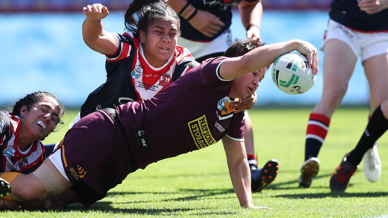 Heather Ballinger, playing for the Brisbane Broncos, scores a try during an NRLW match against the Sydney Roosters. Picture: Brett Costello