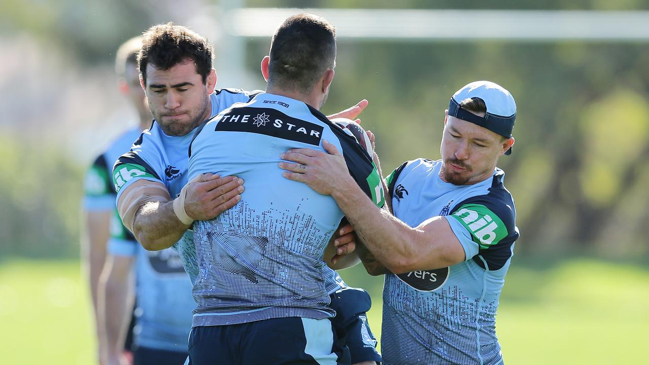 Dale Finucane, Paul Vaughan and Damien Cook during Blues training.