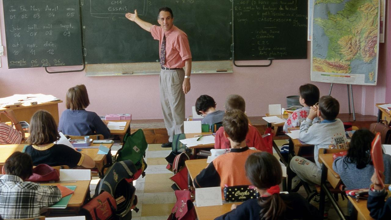 Generic image of teacher teaching students inside school classroom.