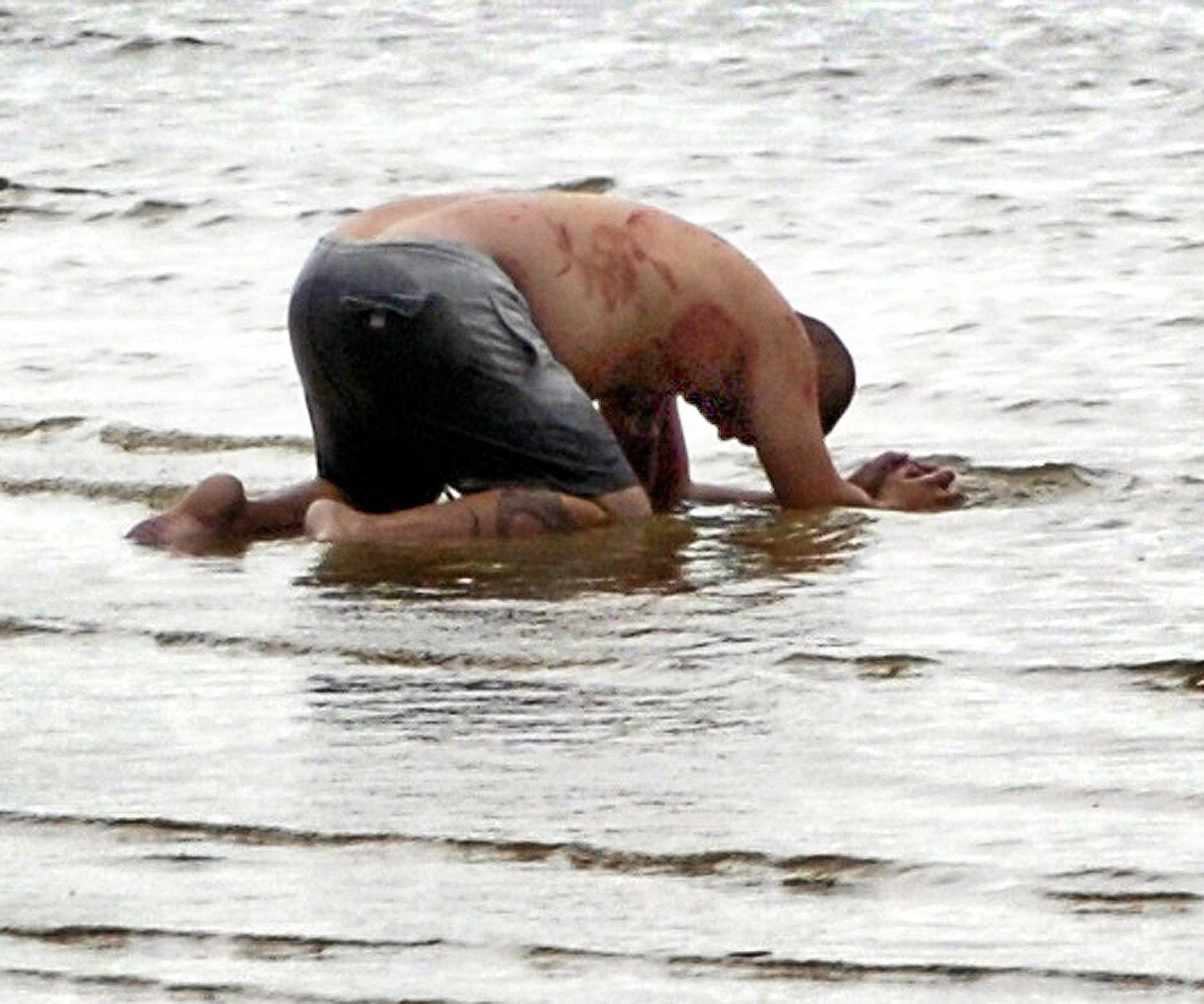 Double stabbing at Urangan - alleged attacker in the water at Urangan beach near marina rock wall.  Hervey Bay man Eric Heuer accused of butchering his housemates, at Urangan on November 18, 2008, has pleaded guilty.