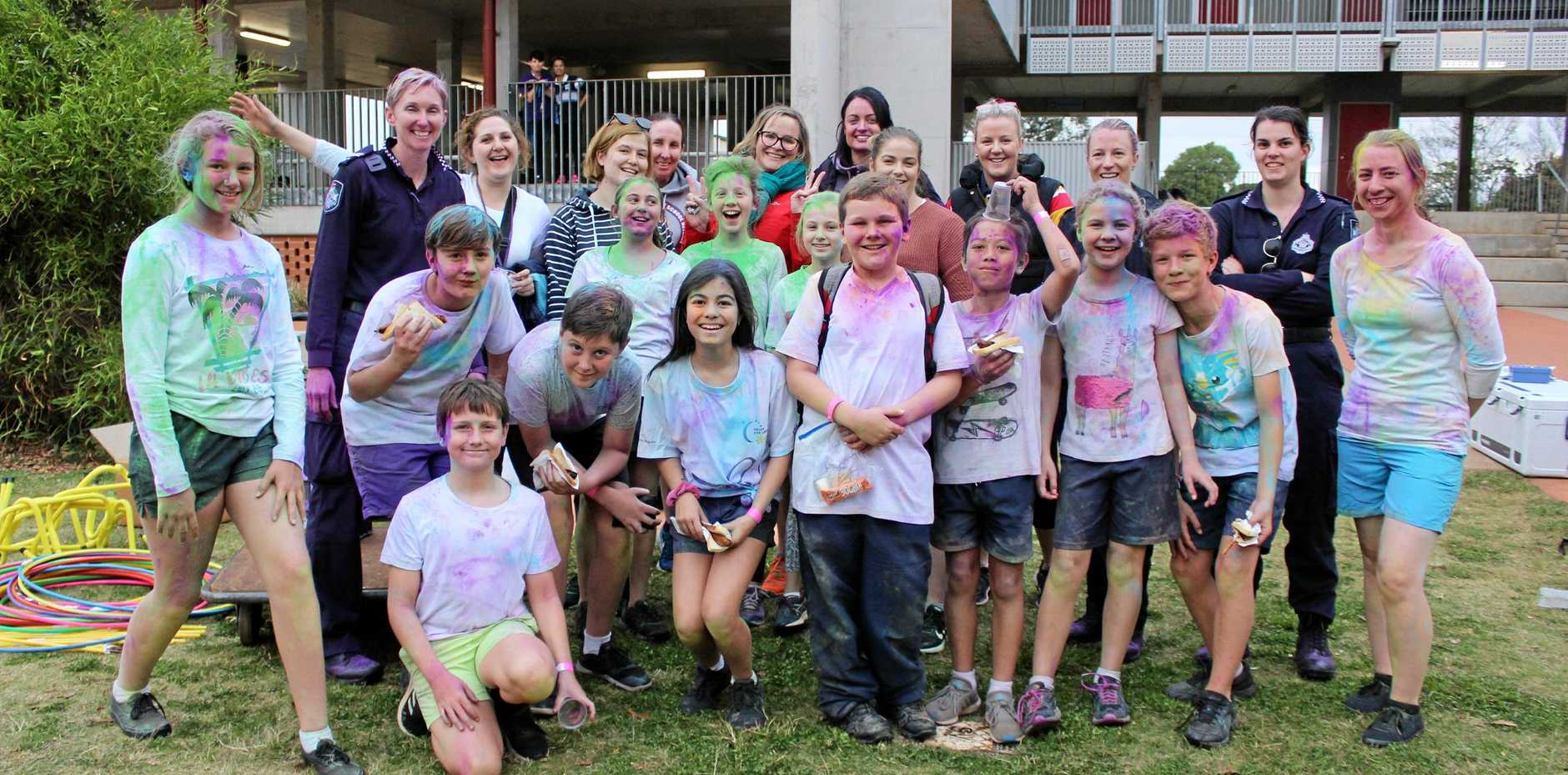 RACED OUT: Colour runners enjoying a well-deserved sausage sandwich after doing multiple laps of the oval.