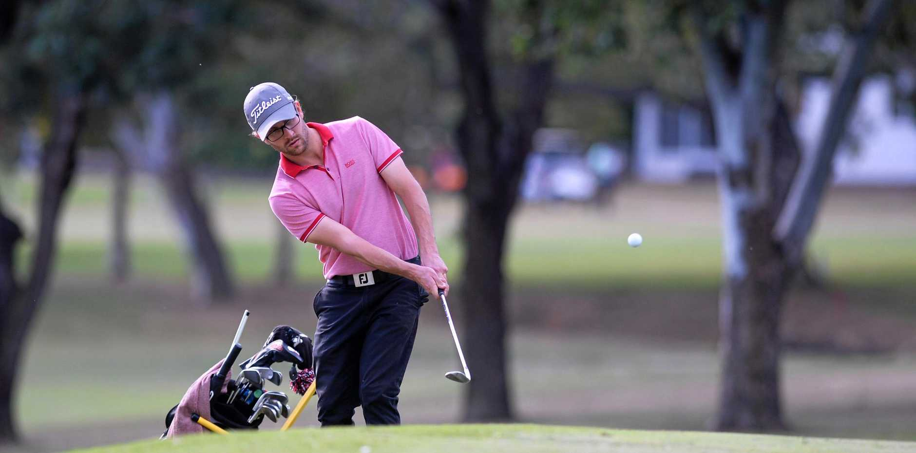 FORE THOUGHT: Nick Sapet chips onto the green during the opening round of the Ian Weigh Toyota Rockhampton Pro-Am yesterday.