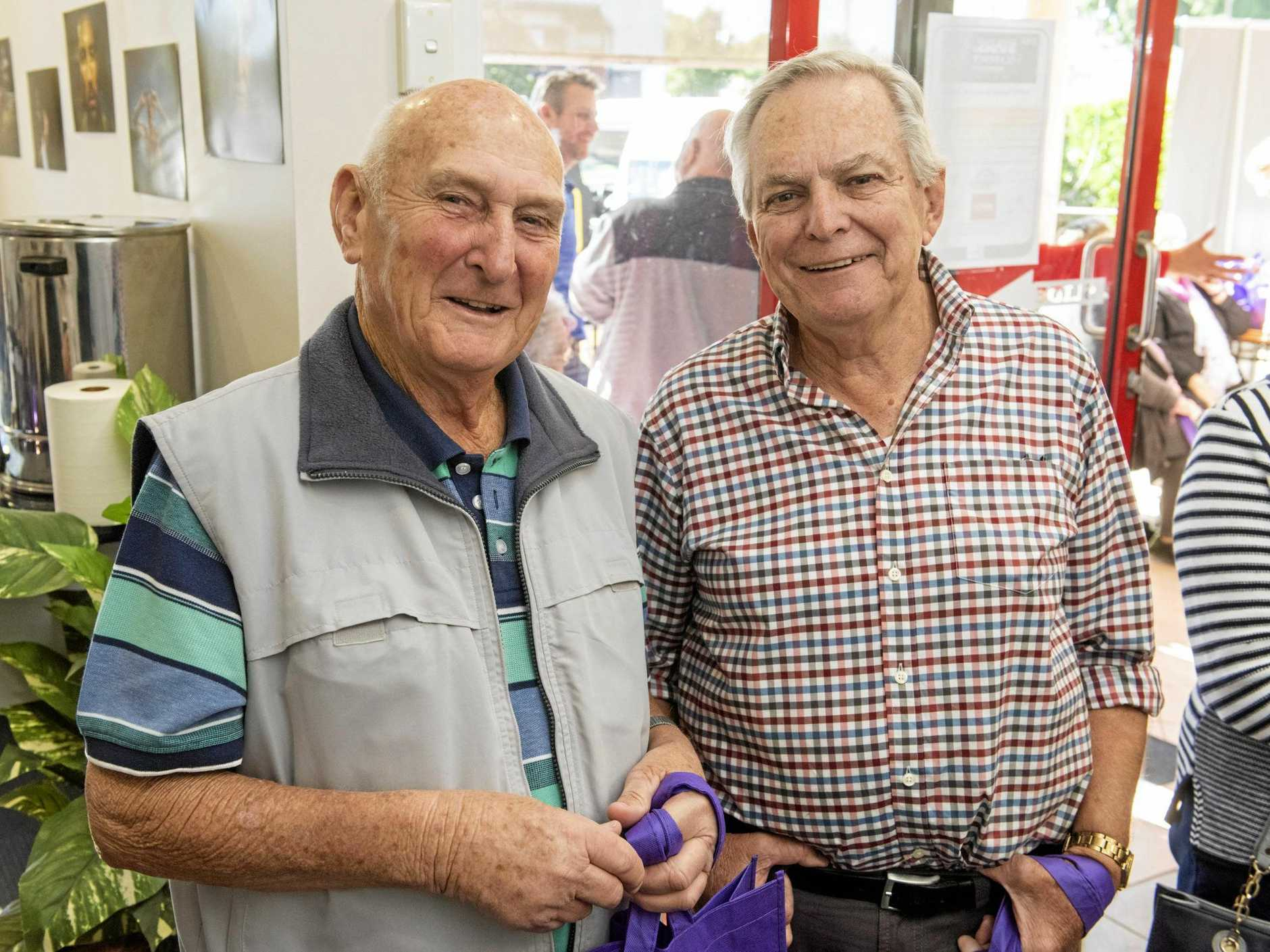 INK IN THEIR VEINS: Former  production staff Bruce Powell and Athol Green caught up at  The Daily Examiner  160th birthday celebrations.