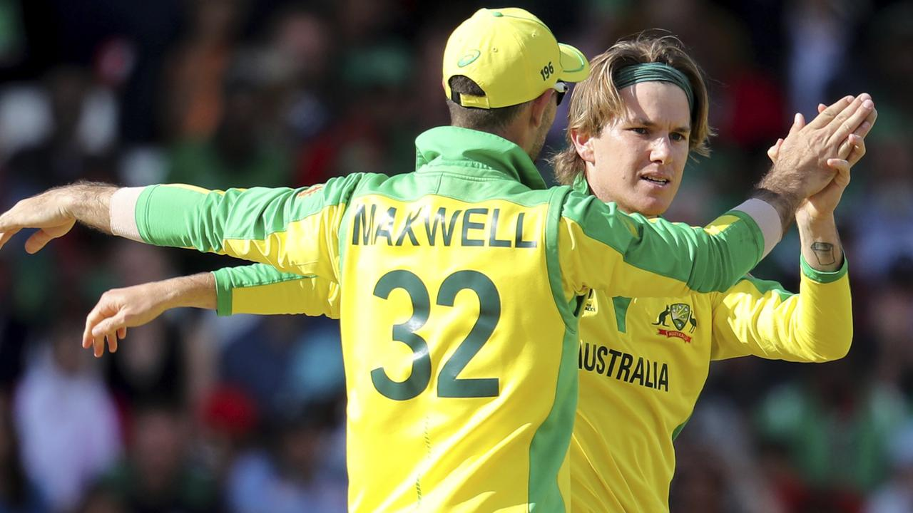 Adam Zampa is congratulated by Glenn Maxwell after taking a wicket.