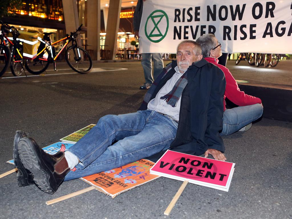Adani protesters blocked an intersection in the cultural precinct of Brisbane last night. Picture: Richard Gosling/AAP