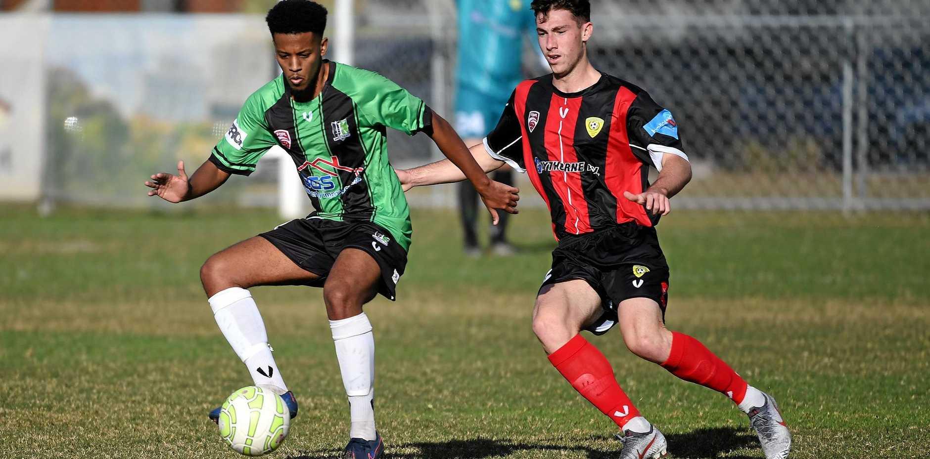 Knights footballer Nahom Woldu retains possession during his team's 1-0 loss to Mitchelton at Bundamba.