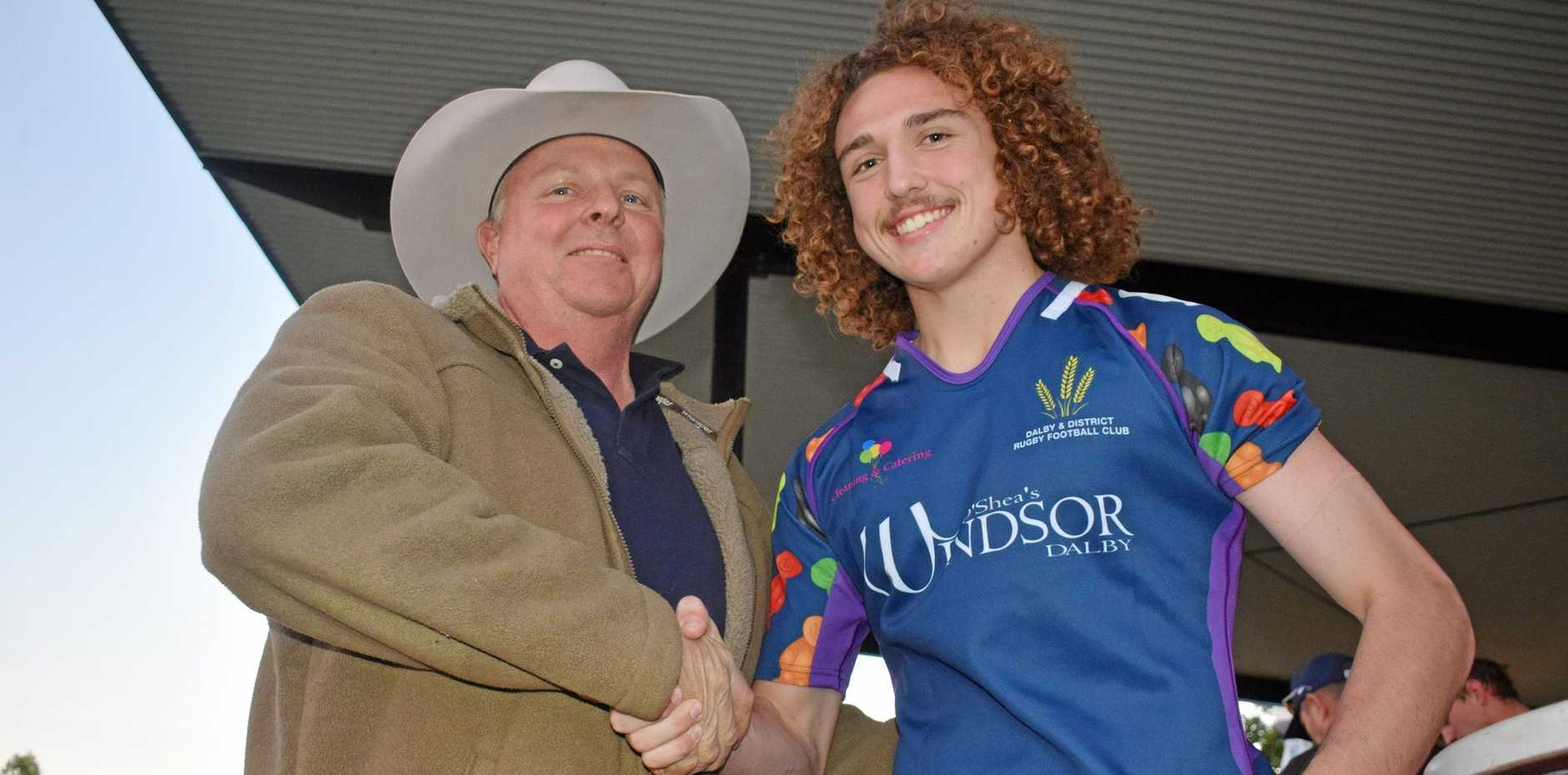 TOP DOLLAR: Anthony Hyde who paid $1000 for jersey number nine shakes hands with Zac Storey.
