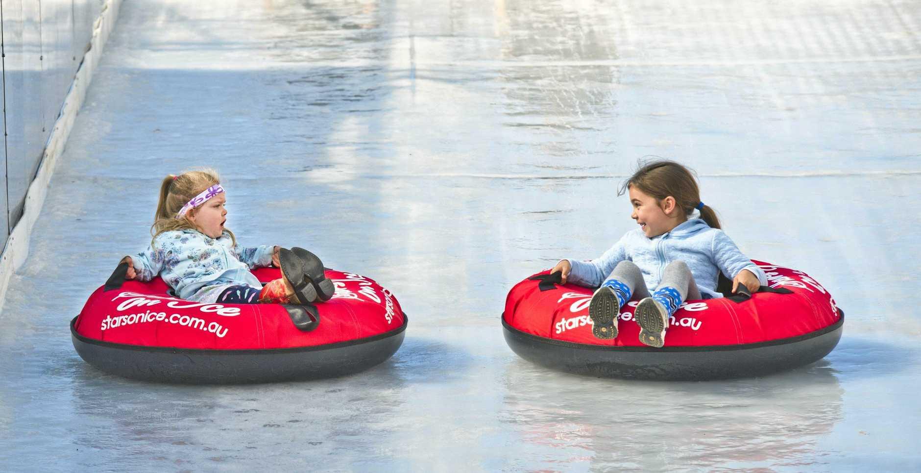 Sisters Lexi and Mackenzie Burlingham take on the Ice Slide at Winter Wonderland.
