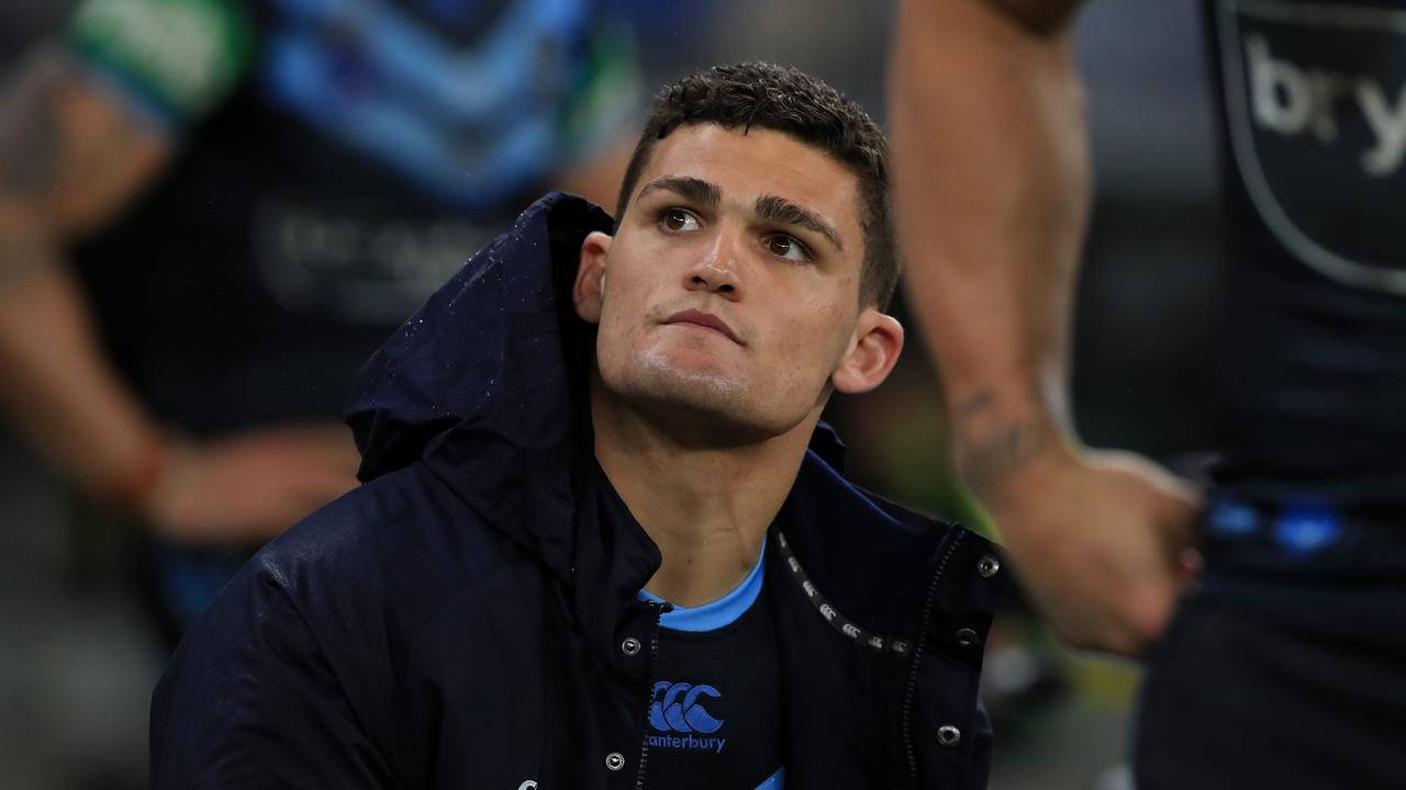 A forlorn Nathan Cleary sits on the sideline after suffering an ankle injury in Origin II. Picture: Adam Head