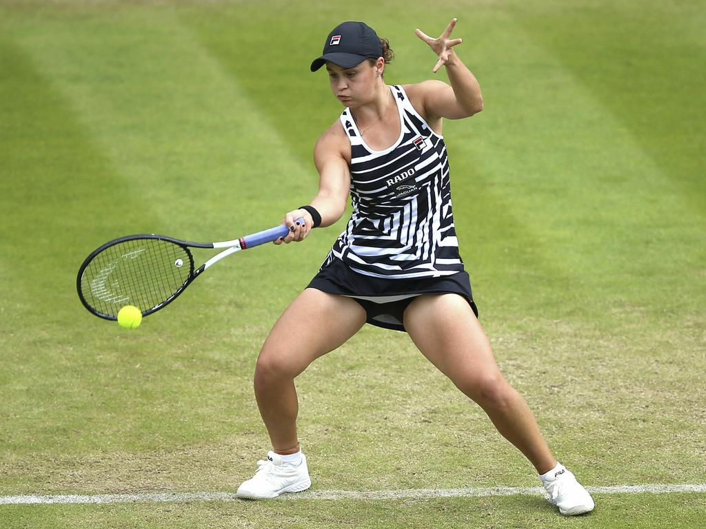 Australia's Ashleigh Barty returns to Venus Williams of the U.S. during day seven of the Nature Valley Classic at Edgbaston Priory Club, Birmingham. Picture: Nigel French/PA via AP