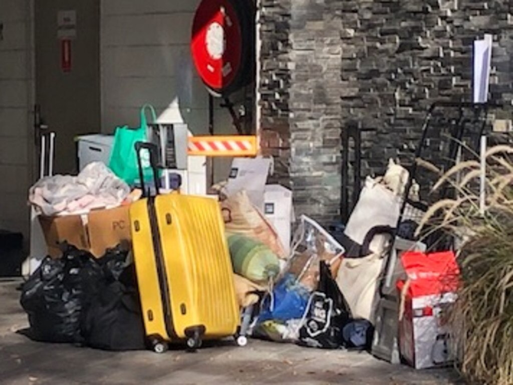 Residents gather their belongings this morning after being granted temporary access to their homes. Picture: Phoebe Loomes
