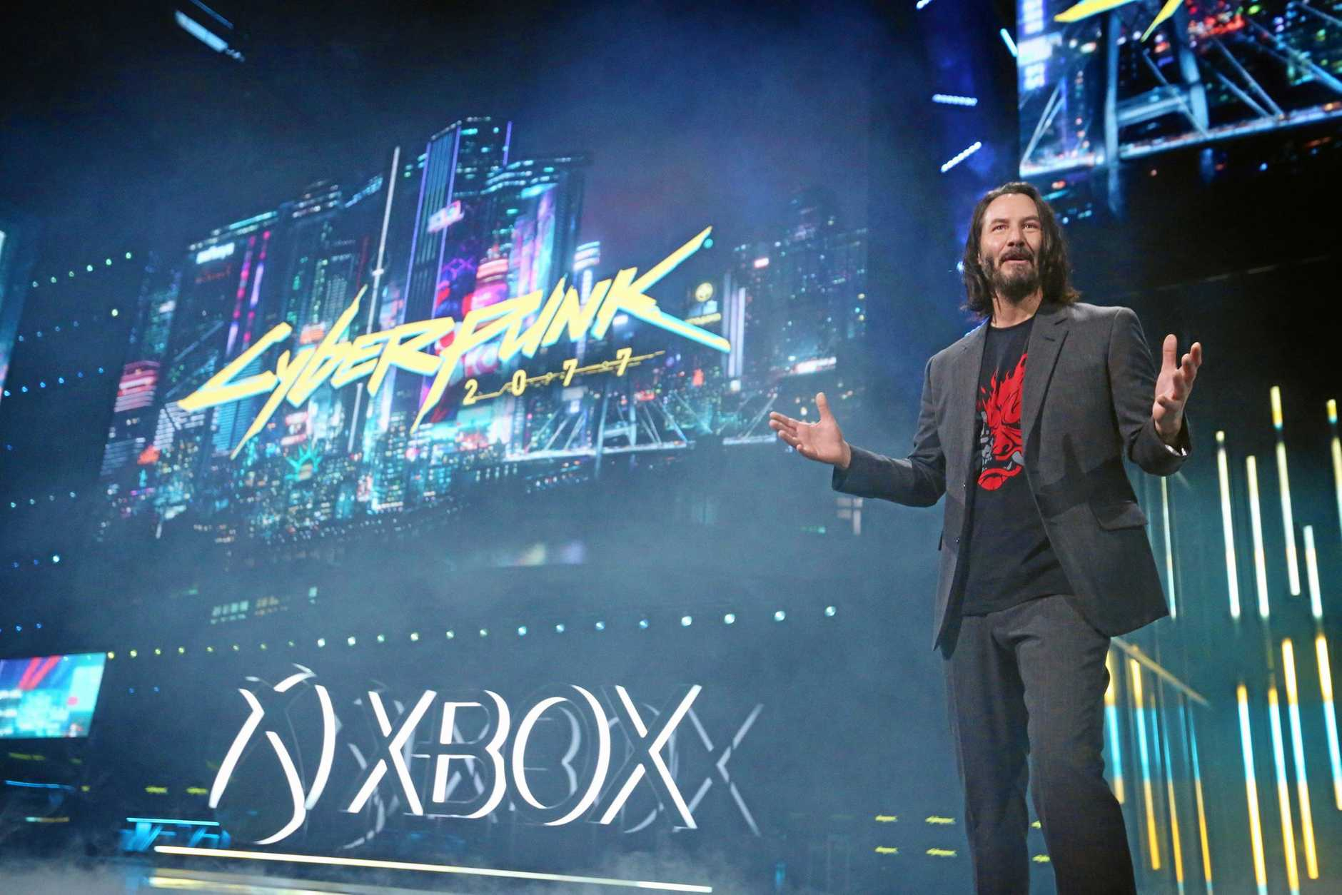 SURPRISE APPEARANCE: Keanu Reeves unveils the Cyberpunk: 2077 release date at the Xbox E3 2019 briefing in Los Angeles.