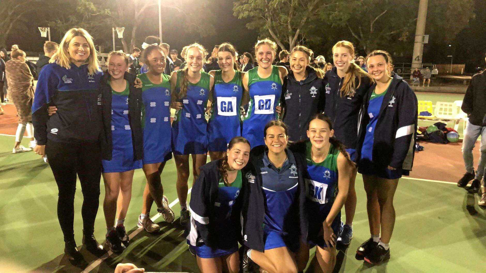 CHAMPIONS: The victorious TCC team with coach Renee Williams after their grand final win over Rockhampton Grammar School.