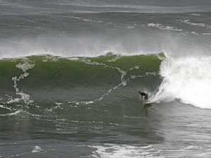 Summer-like swell a welcome surprise for Coast surfers
