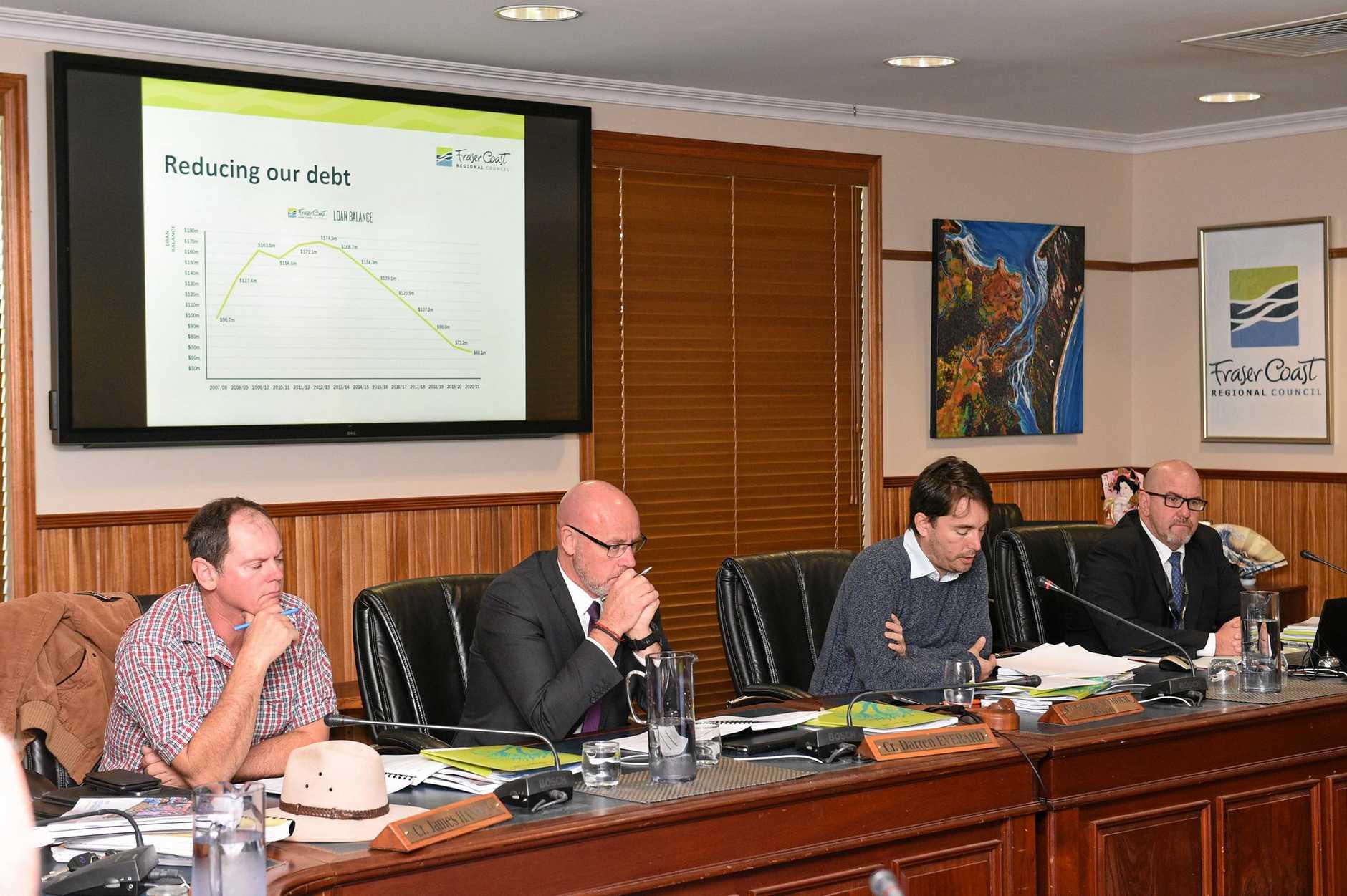 BIG BUDGET SPEND: Fraser Coast mayor George Seymour (centre) reads his budget speech as councillor James Hansen, deputy mayor Darren Everard and CEO Ken Diehm listen.