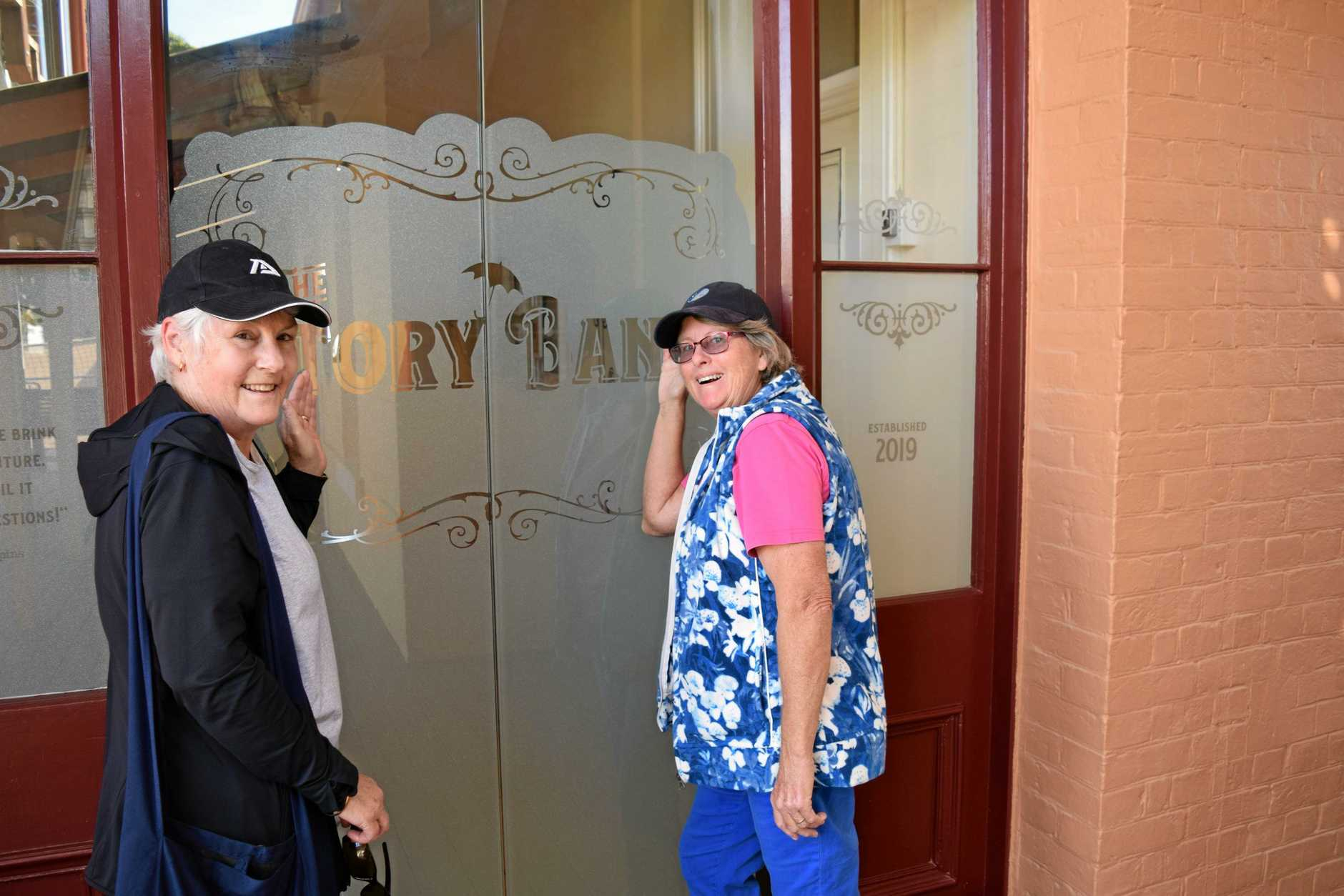 MAGICAL MOMENT: Bookings are a must for the recently opened Story Bank in Maryborough as Beelbi Creek resident Helen Wegner and family visitor from South Australia June Hills (left) found out when they arrived on opening day.