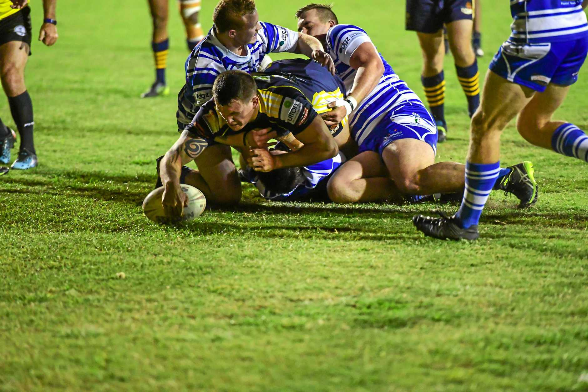 DIVE: The Waves' Reece Maughan crashes through the Brothers' defence to score a try.